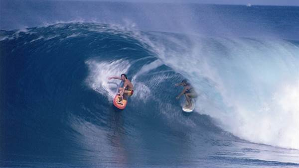 two surfers in tube